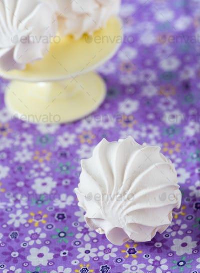 Vanilla marshmallows over purple background