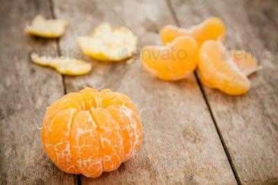 fresh organic tangerines and peeled slices