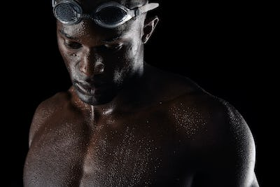 Pensive african male swimmer