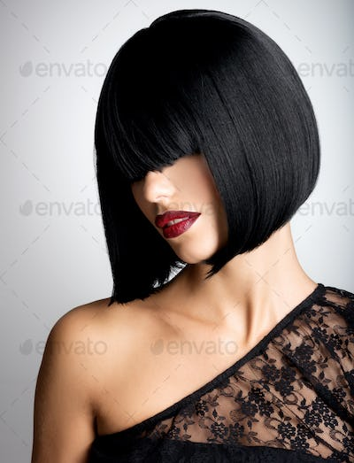 Beautiful brunette woman with shot hairstyle
