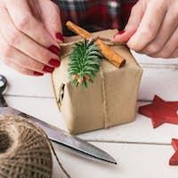 Woman wrapping natural christmas gift