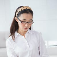 Businesswoman sitting and taking notes in creative office