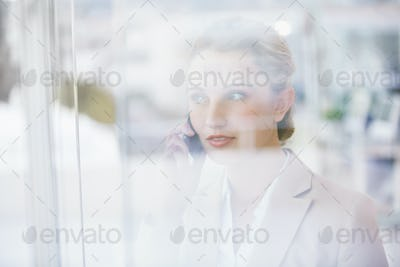 Portrait of a businesswoman making a phone call in the office
