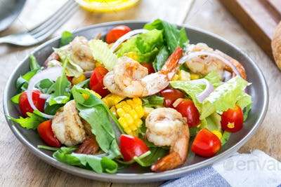 Prawns with sweet corn and rocket salad