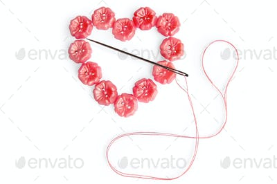 Heart of the buttons with needle