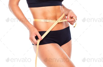 Woman measuring perfect shape of beautiful thigh, healthy lifest