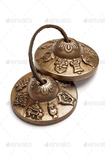 Tibetan Buddhist tingsha cymbals isolated
