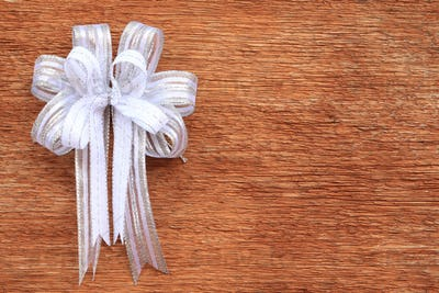White Bow on Old Wood Background