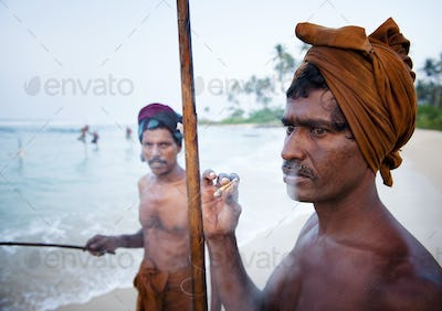Fisherman Smoking By The Shore