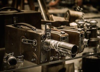 Vintage cameras and lenses on a shelf
