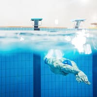 Swimmer under water in swimming pool