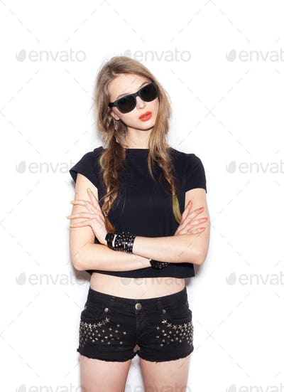 Fashion girl hipster with two long braids in sunglasses