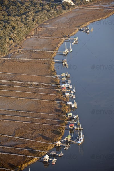 aerial shot of docks and boats