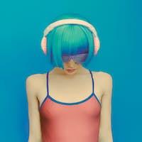 unreal DJ girl in fashionable headphones listening to music