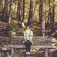 Portrait of fashionable stylish brunette in autumn forest