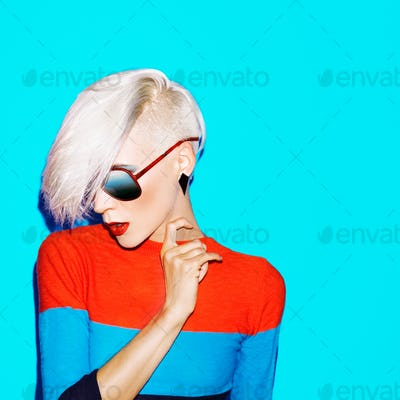fashion blond woman with trendy hairstyle and sunglasses on a bl
