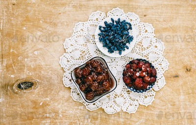 Berry jam on a beautiful napkin on a wooden background