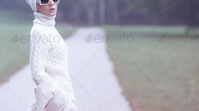 Portrait stylish lady in white glamorous clothes. Fall Winter fa