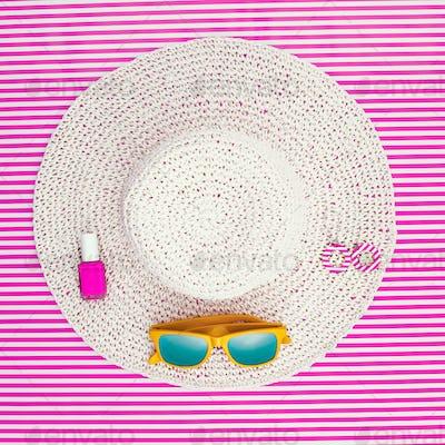 Summer fashion ensemble on a striped background