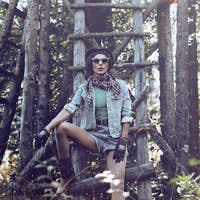 fashion portrait brunette girl country style in the autumn fores
