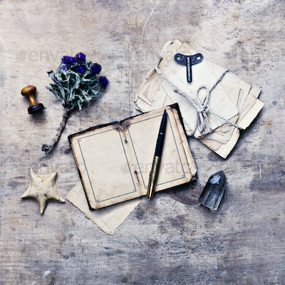 Traveler researcher notes on old wooden background