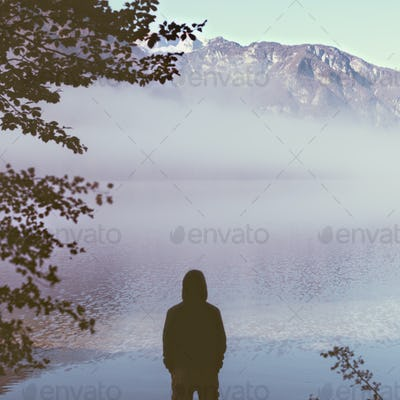 Man tourist in thick fog on the lake enjoying life.