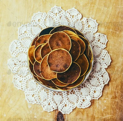 Village pancakes on wooden background on patterned napkins