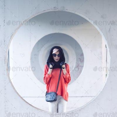 Glamorous Blonde standing at the wall. Urban Fashion