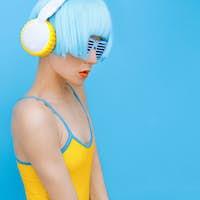 sensual DJ-lady in style headphones listening to music