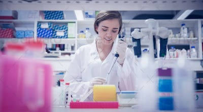 Pretty science student using pipette at the university
