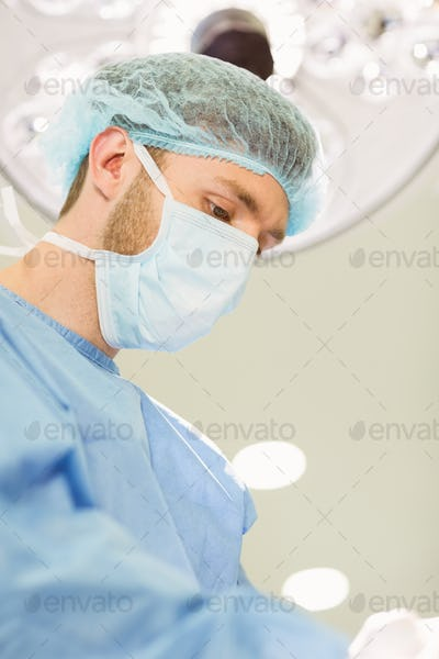 Young surgeon wearing mask and cap at the university