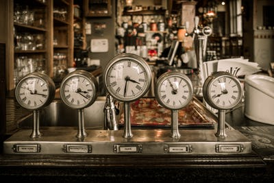 Vintage clocks on a bar counter in a pub