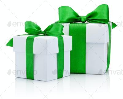 Two White boxs tied green ribbon bow Isolated on white backgroun