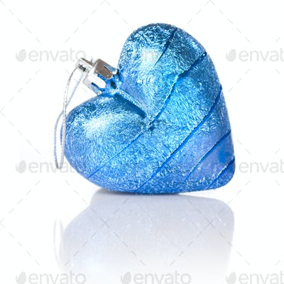 blue christmas ball in shape of heart isolated on white