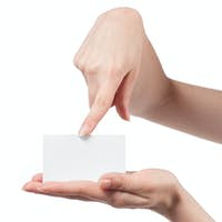 Woman hand holding empty visiting card and pointing on it isolat