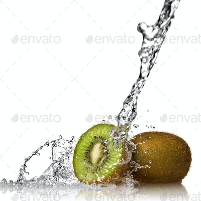 Water splash on kiwi isolated on white