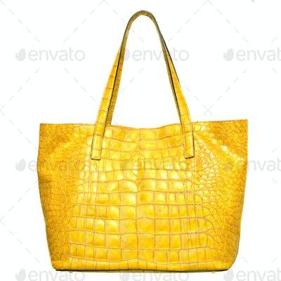 luxury yellow leather female bag isolated on white