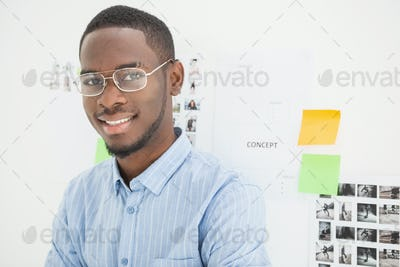 Portrait of smiling businessman with glasses in the office