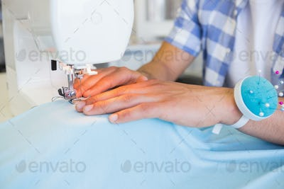 College student using sewing machine at the college