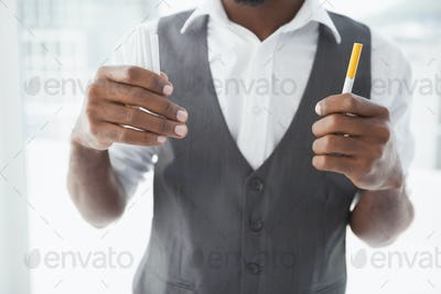 Casual businessman holding cigarettes in the office