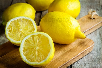 Fresh juicy lemons on a cutting board