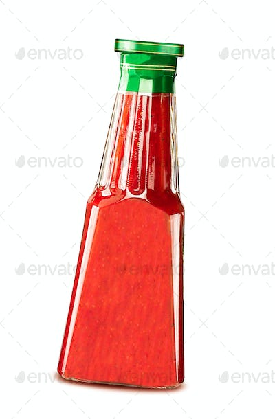 Glass bottle of ketchup isolated