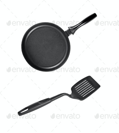 Pan with black plastic kitchen spatula