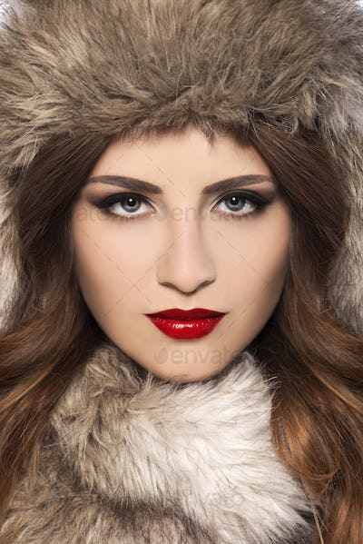 Beautiful young woman with fur hat