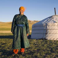Mongolian Woman Standing In Front Of The Tent Outdoors