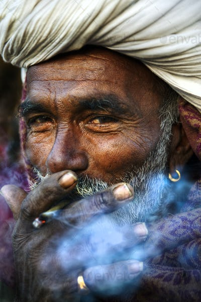 Indigenous Indian Man Smoking Happily