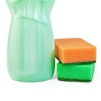 Bottle of detergent and sponges