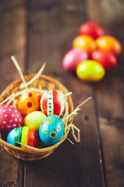 Painted eggs in basket