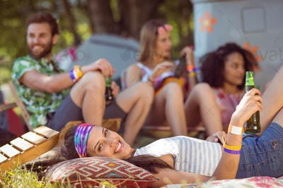 Happy hipsters relaxing on the campsite at a music festival