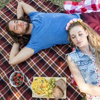 Cute couple having a picnic on a summers day
